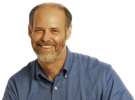 Gary Karp, smiling, wearing a blue shirt, smiling